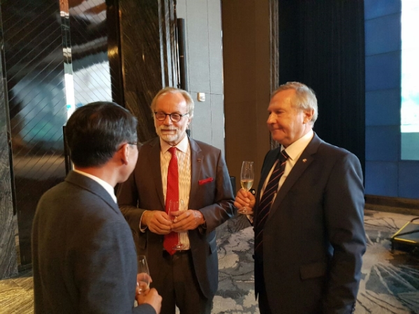 Austria Amb. Michael Schwarzinger (right) chatting with EU Amb. Michael Reiterer (center) during the 2018 Austria National Day fete.