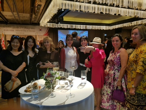 Mme. Maia Gogoladze (center) celebrating her country's Independence Day with wives of Ambassadors during the fete.